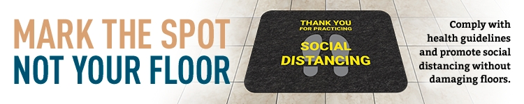 Social distancing sign laying on a tile floor